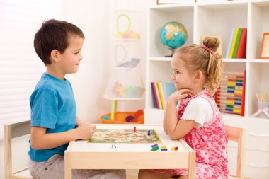 Kids playing board game in their room