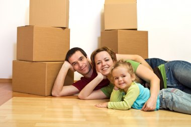 Happy family laying on the floor in their new home