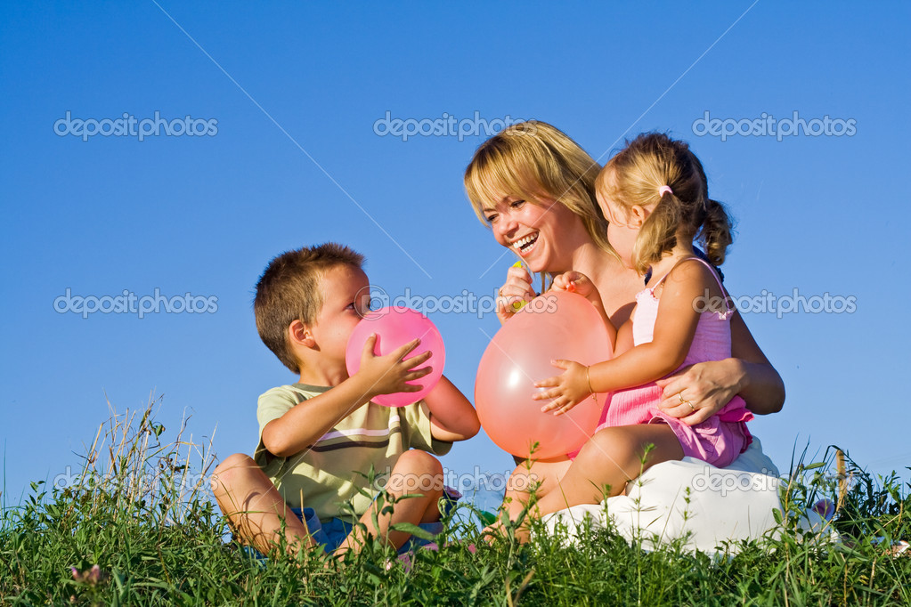 Woman and her kids playing