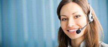 Portrait of happy smiling support phone operator in headset at w