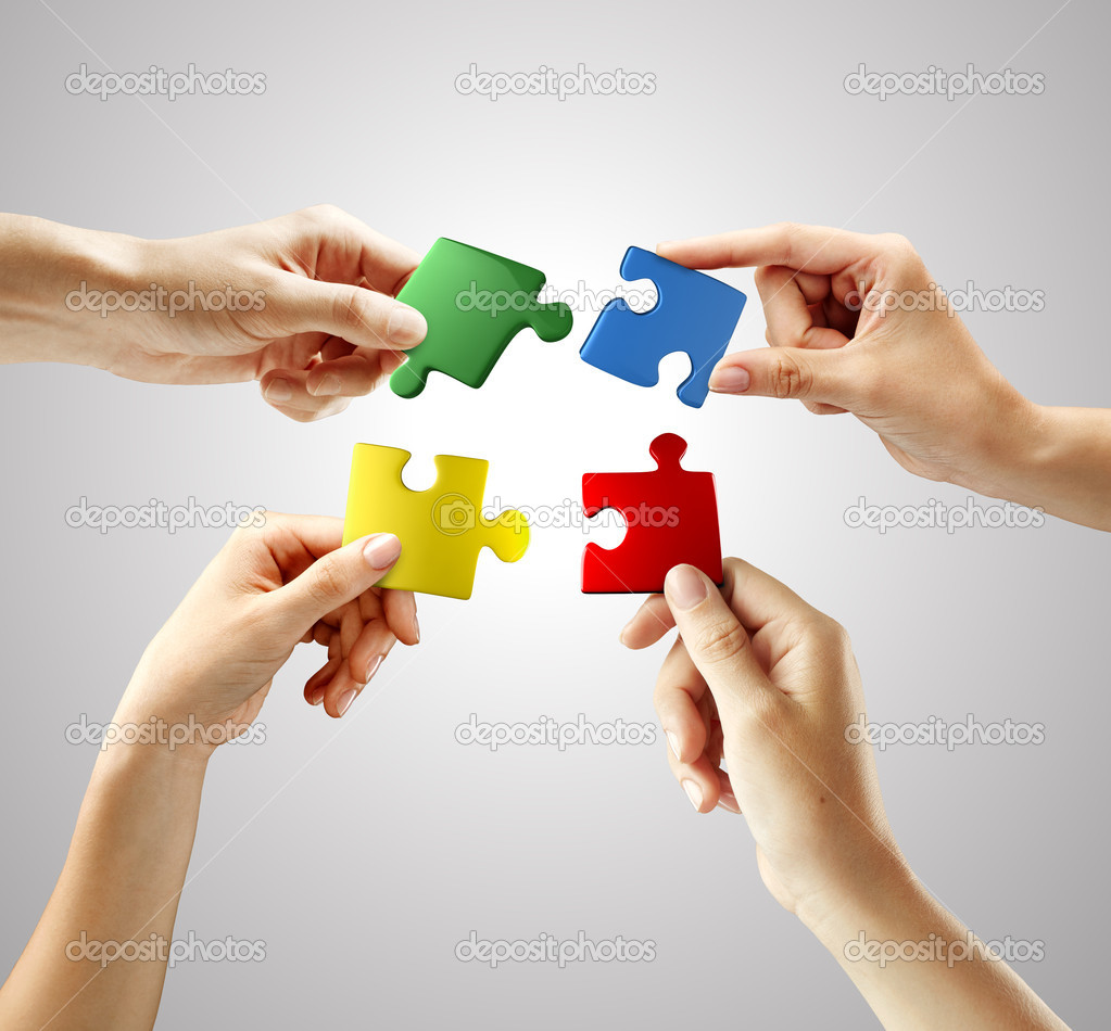 Hands and puzzle on gray background