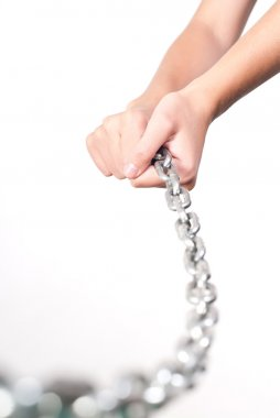 Hands holding chain