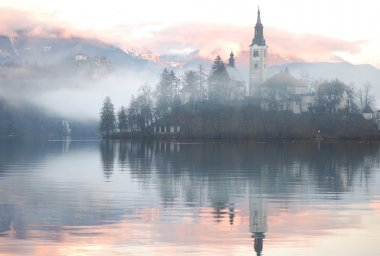 Misty evening at the Bled lake, Slovenia stock vector
