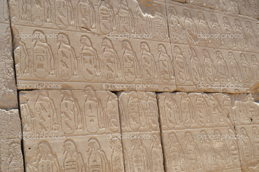 Hieroglyphic carvings in an egyptian temple wall — stock