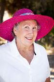 Fotografie starší dáma v klobouku slunce