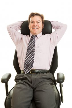 Happy Executive in Ergonomic Chair