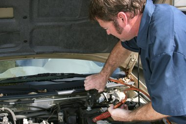 Mechanic Using Jumper Cables