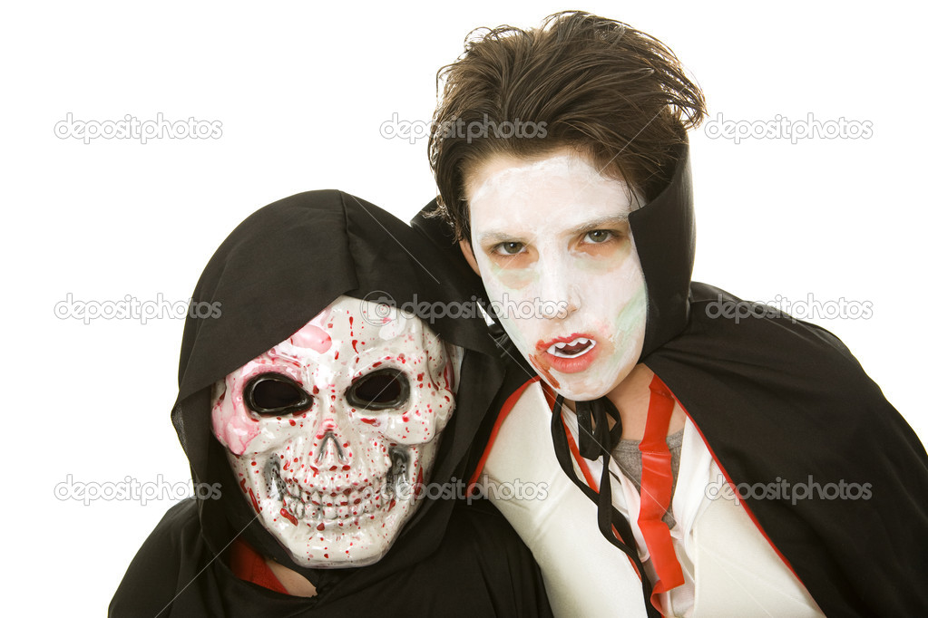 portrait of two boys dressed in scary halloween costumes isolated on white u2014 photo by lisafx