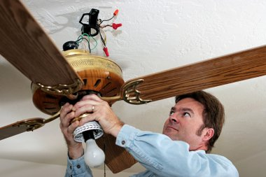Electrician Removes Ceiling Fan