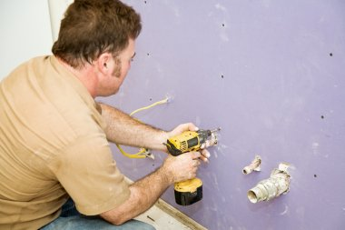 Carpenter Installs Drywall