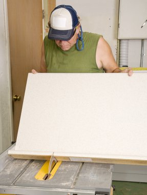 Carpenter Using Table Saw