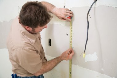 Worker Measuring and Marking