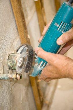 Plumber Grinding Pipe