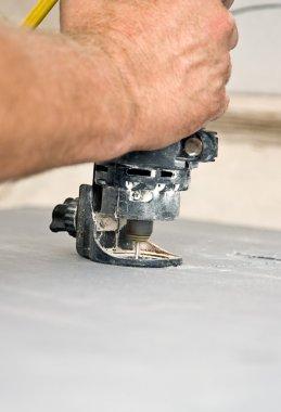 Spiral Saw Cuts Drywall Closeup