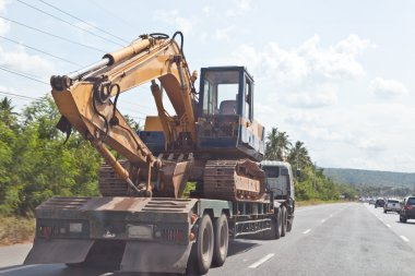 Tractor Excavator on truck, moving