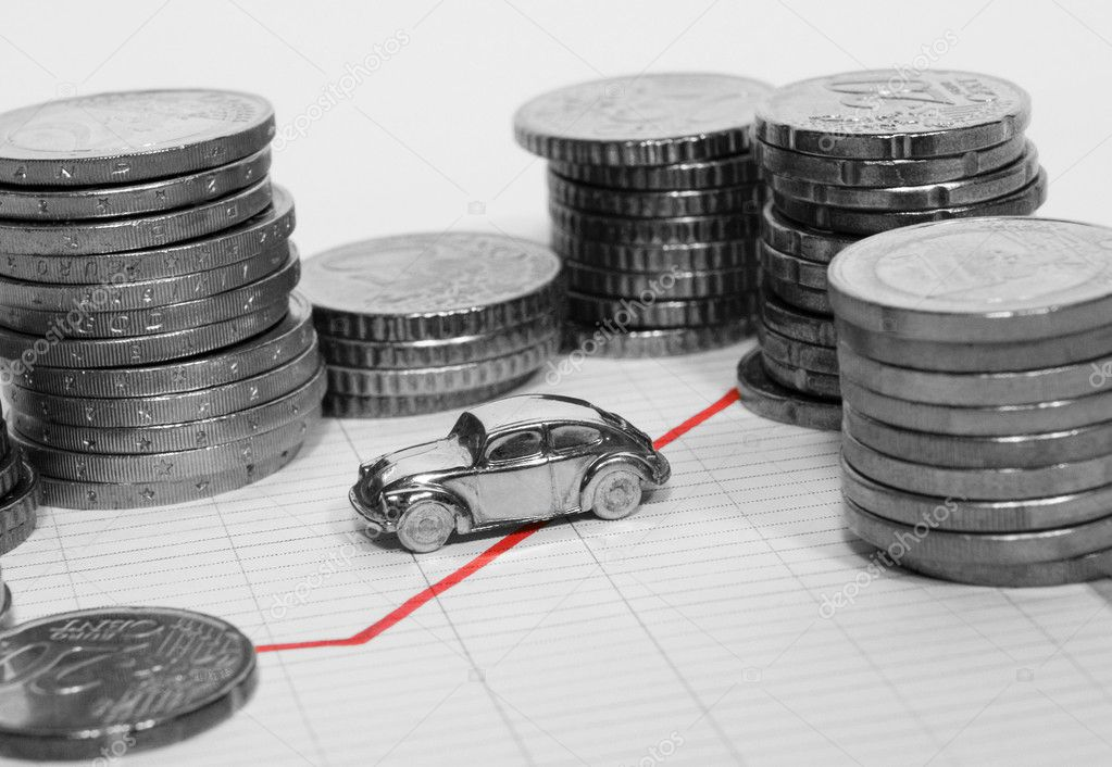 Car Surrounded By Stacks Of Coins