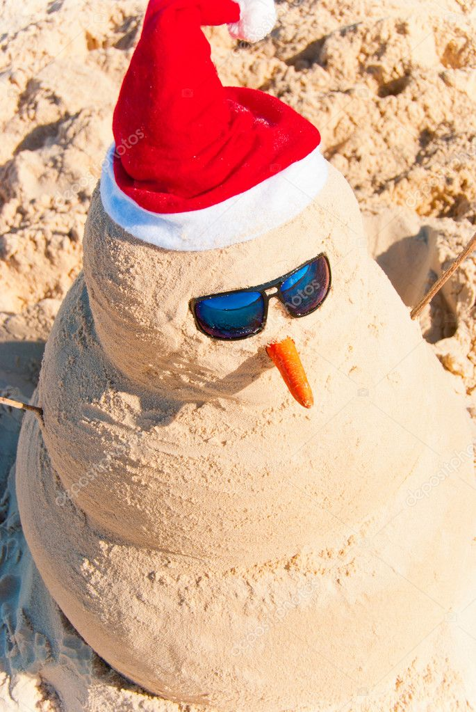 Sand Build Snowman With Sunglasses