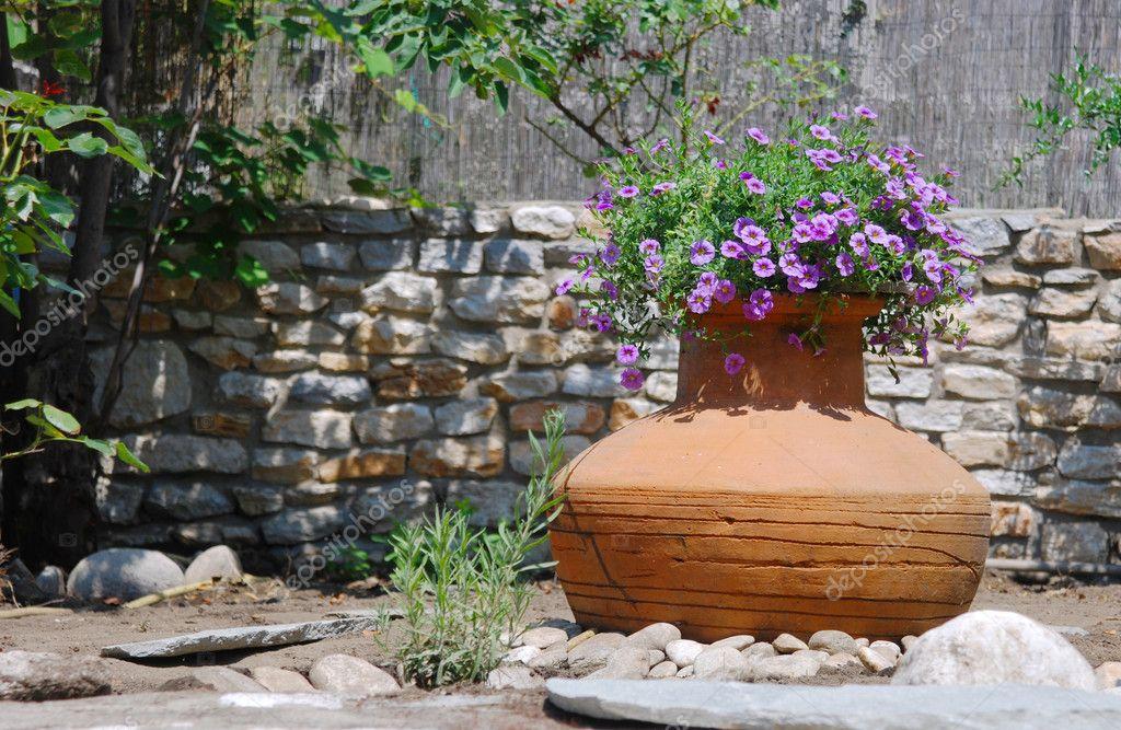Amphora Used As Flowerpot
