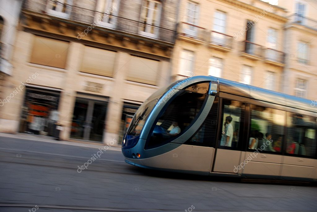 Fast Moving Tram Through Shopping District Captured With Motionblurr