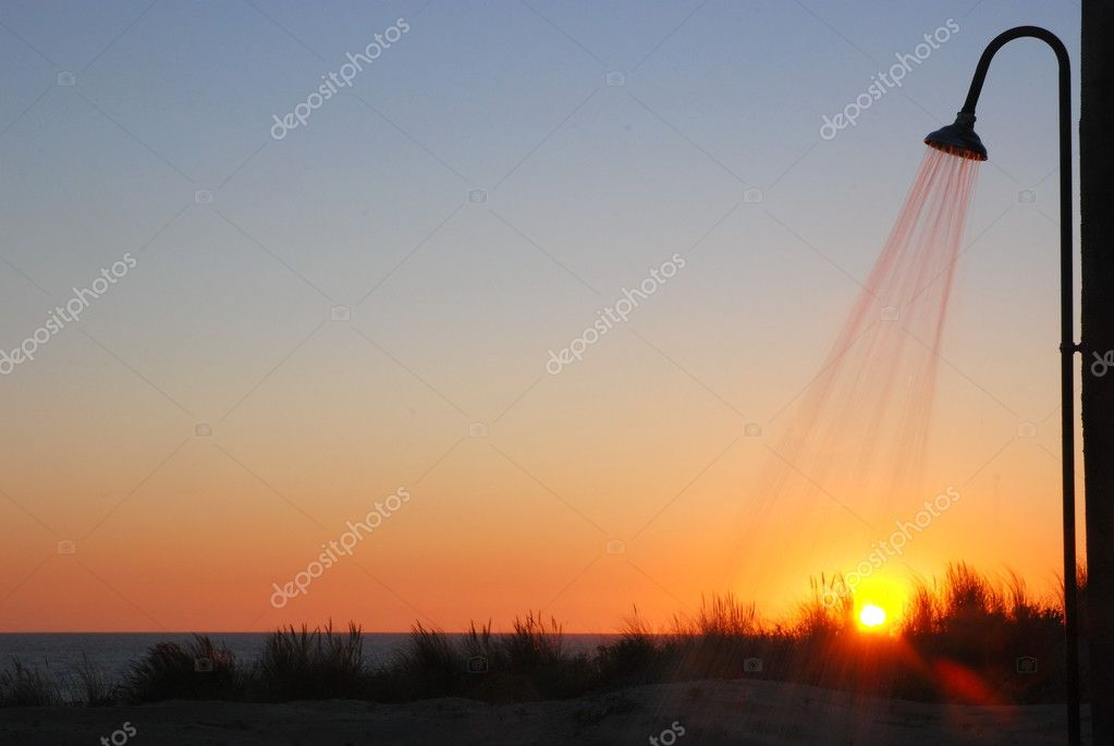 Shower At The Beach During Sunset Sunbathing Concept
