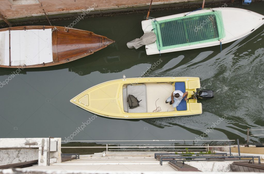 Top View On Moving Boat In Canal