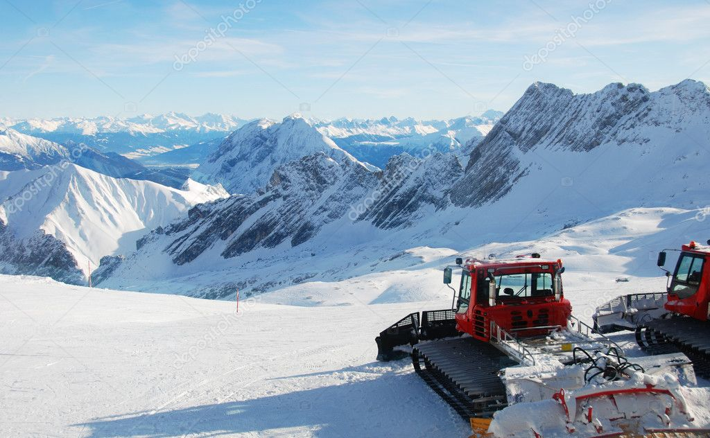 Snowcats Parked On Top Of Mountain