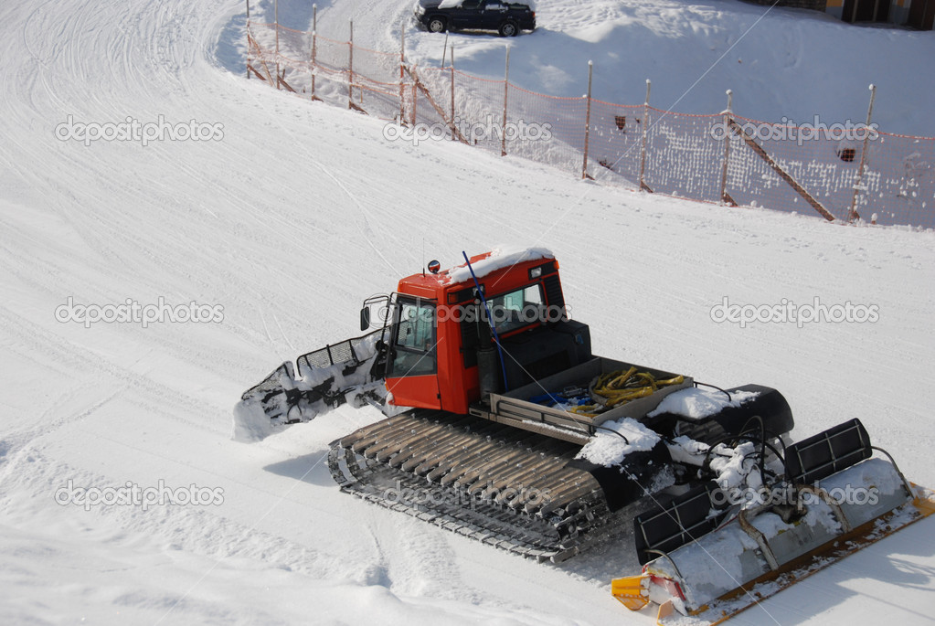 Snowcat Moving Slowly On Runway