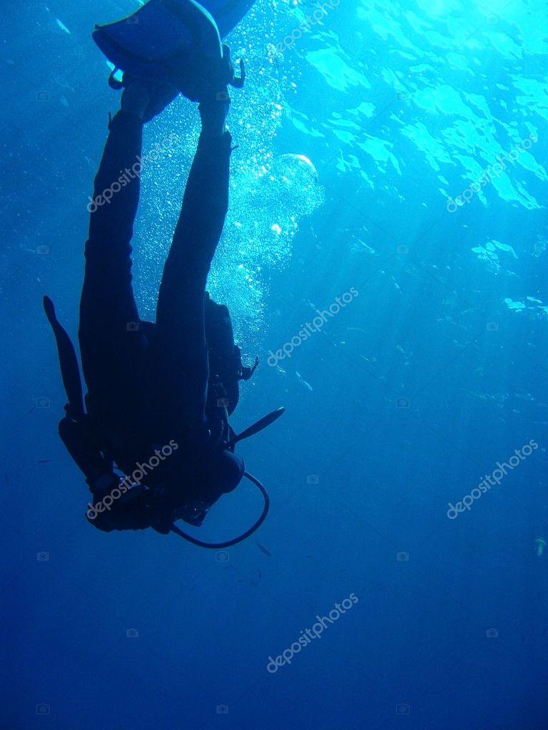 Scuba Diver Against Surface