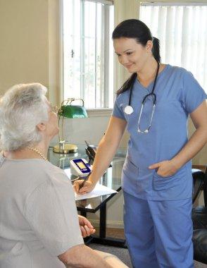 Young nurse with senior patient