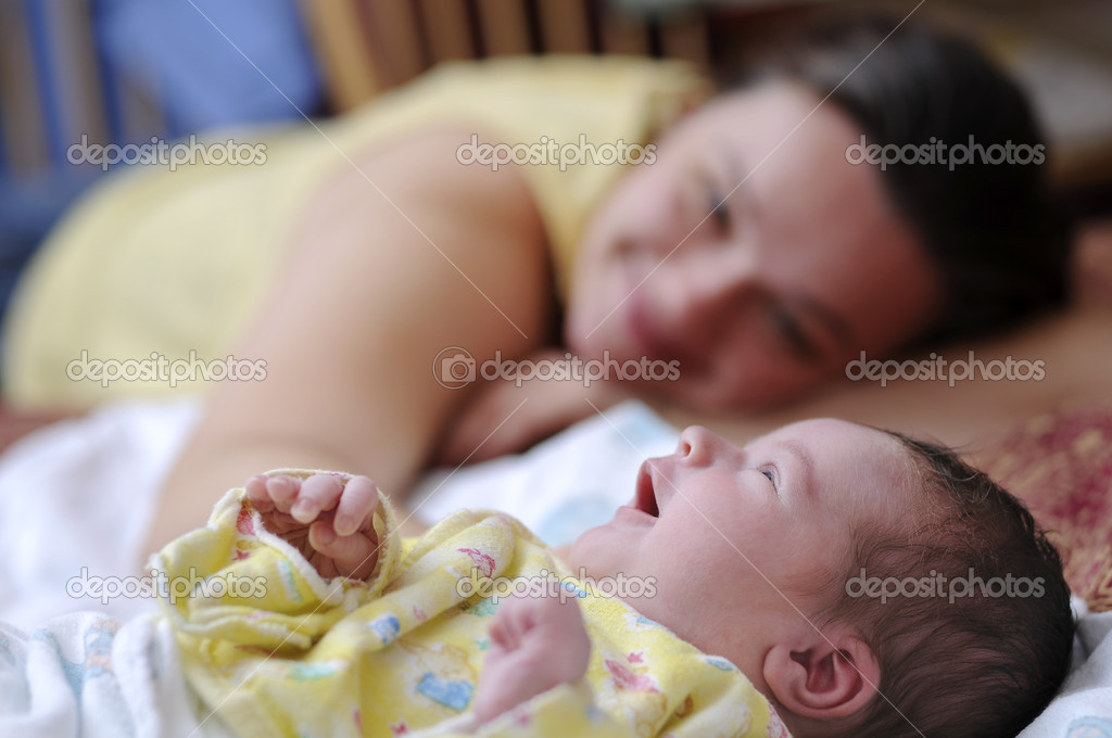 Picture of happy mother with newborn baby