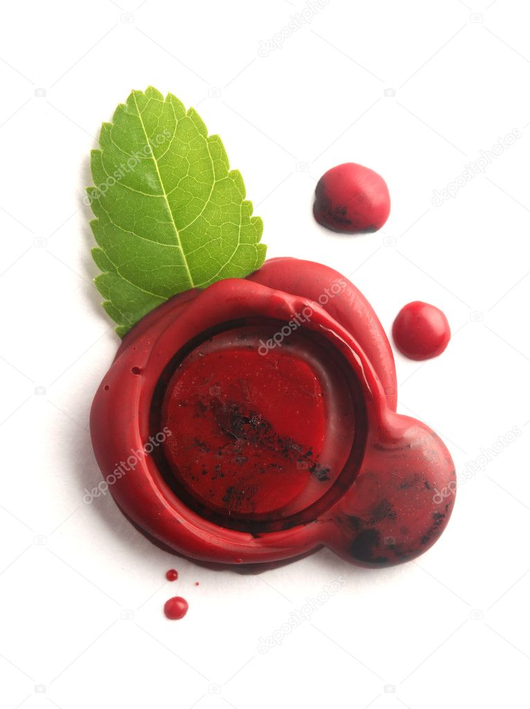 Red wax seal with green leaf