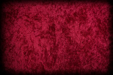 Red velvet-like fabric for background or texture.
