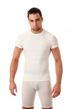 Man in tight wihite shirt and shorts.