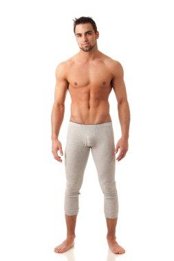 Attractive man in long underwear. Studio shot over white.