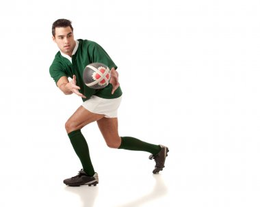 Male rugby player. Studio shot over white.
