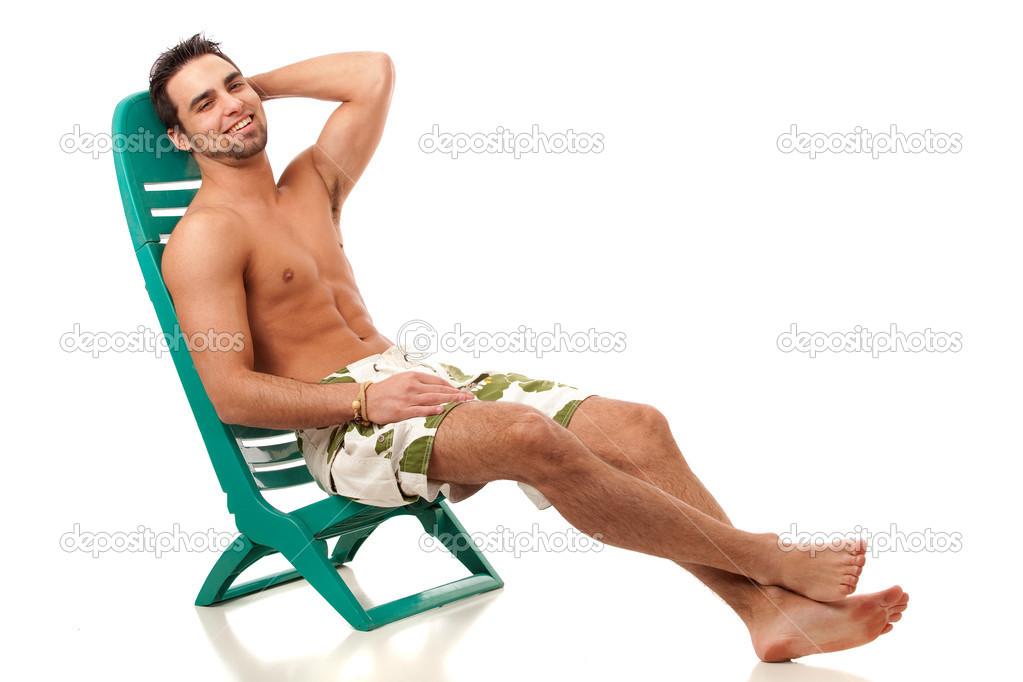 f976cab6c5 Attractive young man in boardshorts. Studio shot over white.– stock image