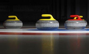 Four curling stones