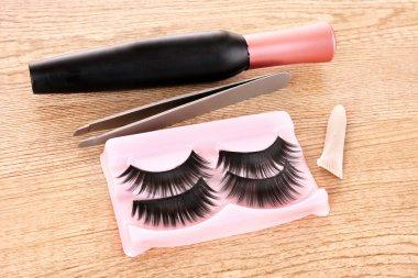 False lashes and mascara on the table