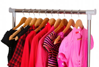 Different clothes on wooden hangers