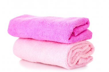 Pink stacked bathroom towels on a white background