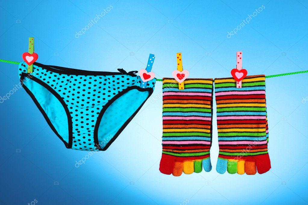 9bdac5dabbc1 Woman's panties hanging on white background — Stock Photo ...