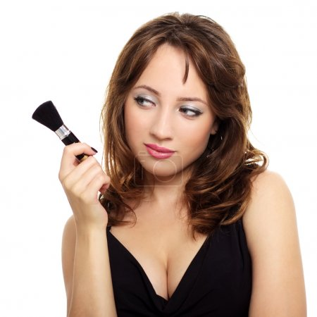 An attractive young lady with makeup brush