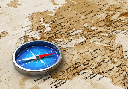 Photo for Macro view of blue metal compass on the old world map - Royalty Free Image