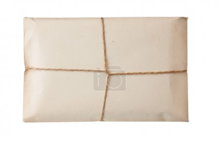 Photo for Parcel wrapped with brown kraft paper isolated on white background - Royalty Free Image