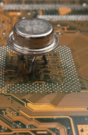 Photo for Old silicon chip on the electronic board - Royalty Free Image