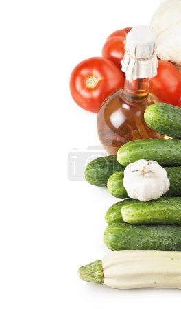 Vegetables and a bottle of oil, still life isolated