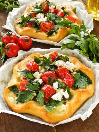 Photo for Homemade tarts with cottage cheese, herbs and cherry tomatoes. Shallow dof. - Royalty Free Image