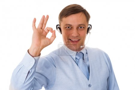 Young businessman with headset talking