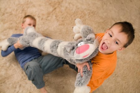 Photo for Merry boys playing with a big toy - Royalty Free Image