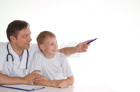 A doctor with a boy-patient